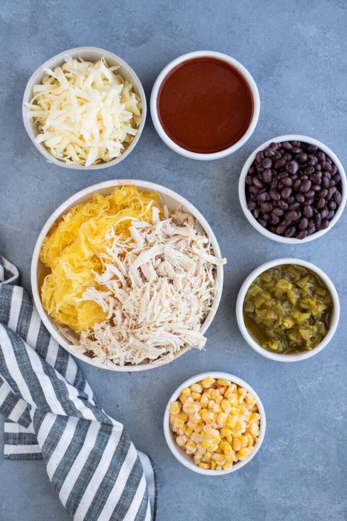 Baked Spaghetti Squash Casserole Ingredients in small white bowls